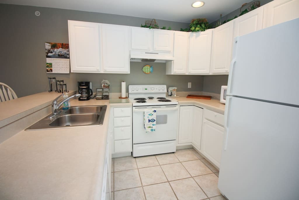 The kitchen is squeaky clean and has everything you need