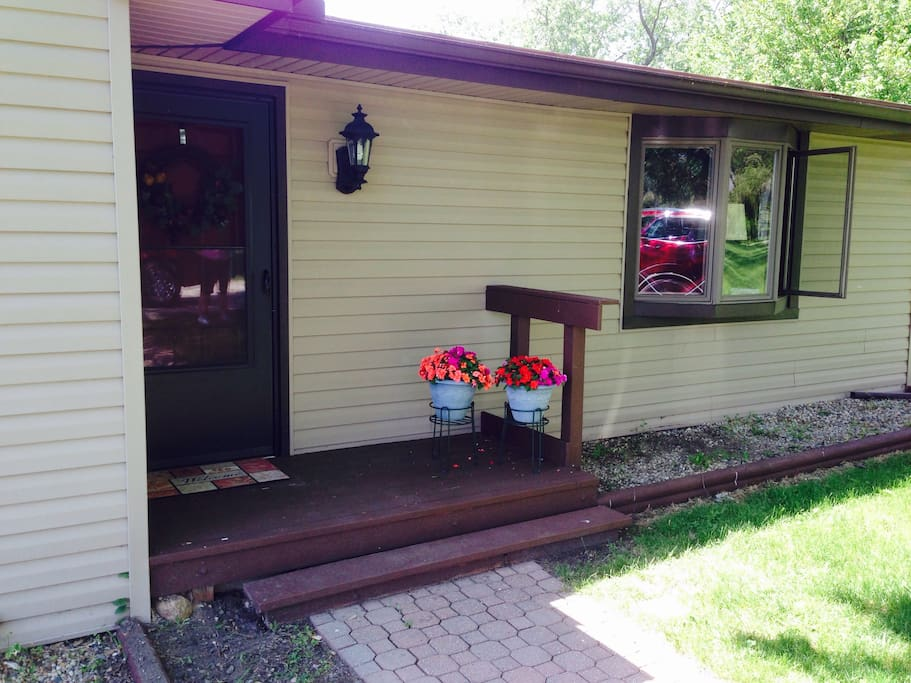 Well lighted front entryway just steps away from your car