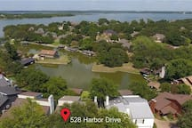 Drone photo of house, dock and cove