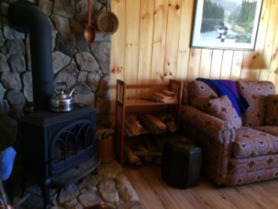 Cozy wood stove in LR with cathedral cieling