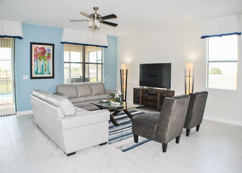 """Living area with 60"""" LCD cable TV"""
