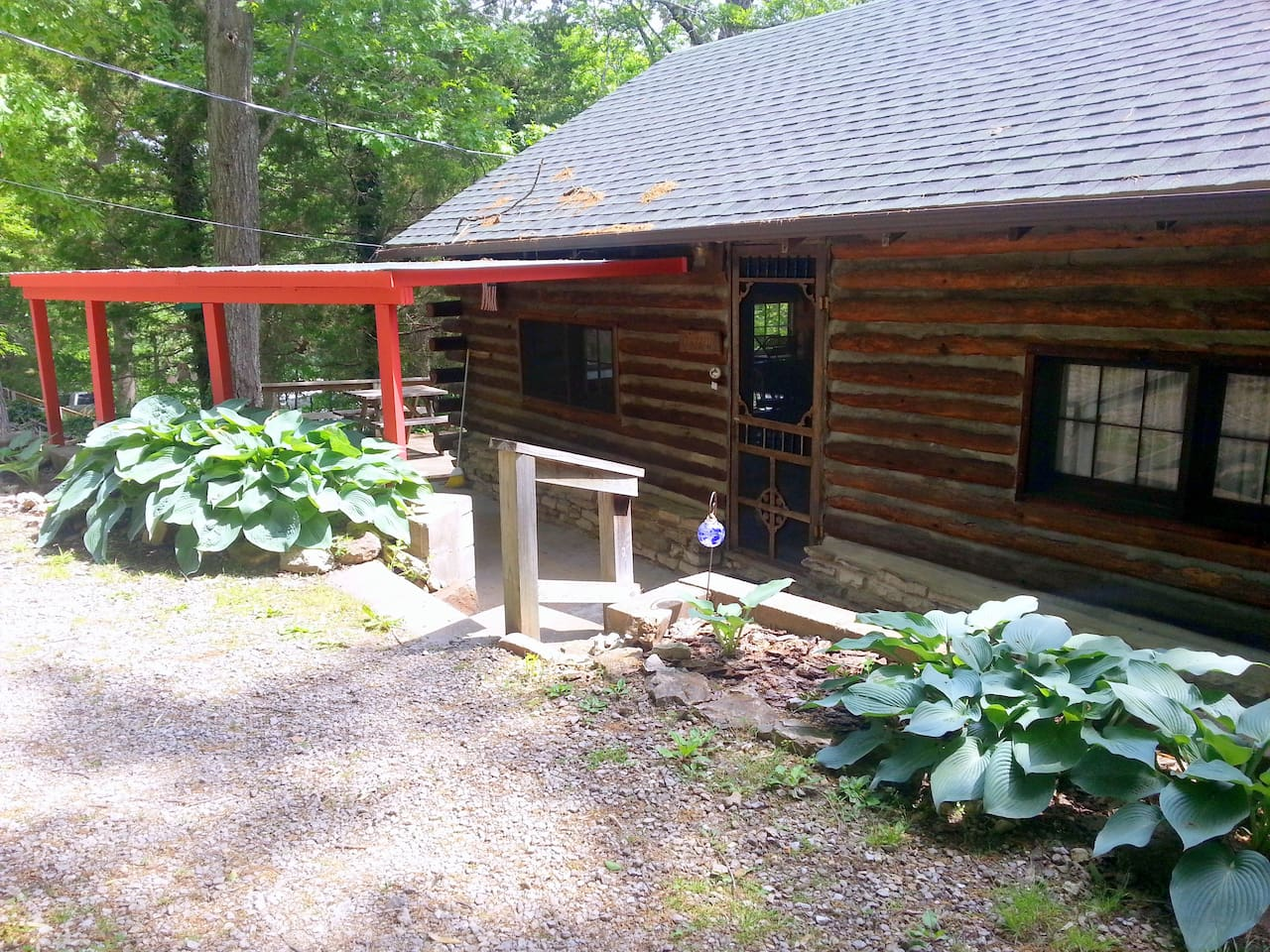 Real log cabin with 2 Bedrooms and Sleeping Porch. Walk down to Private Boat Dock.