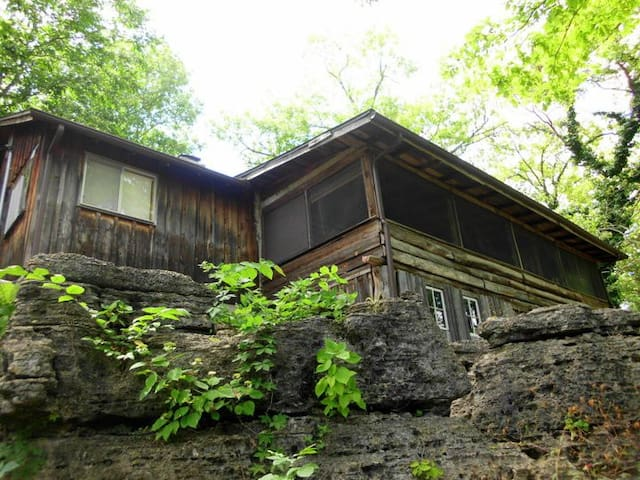 Cabin is perched on large rock outcropping overlooking the lake.