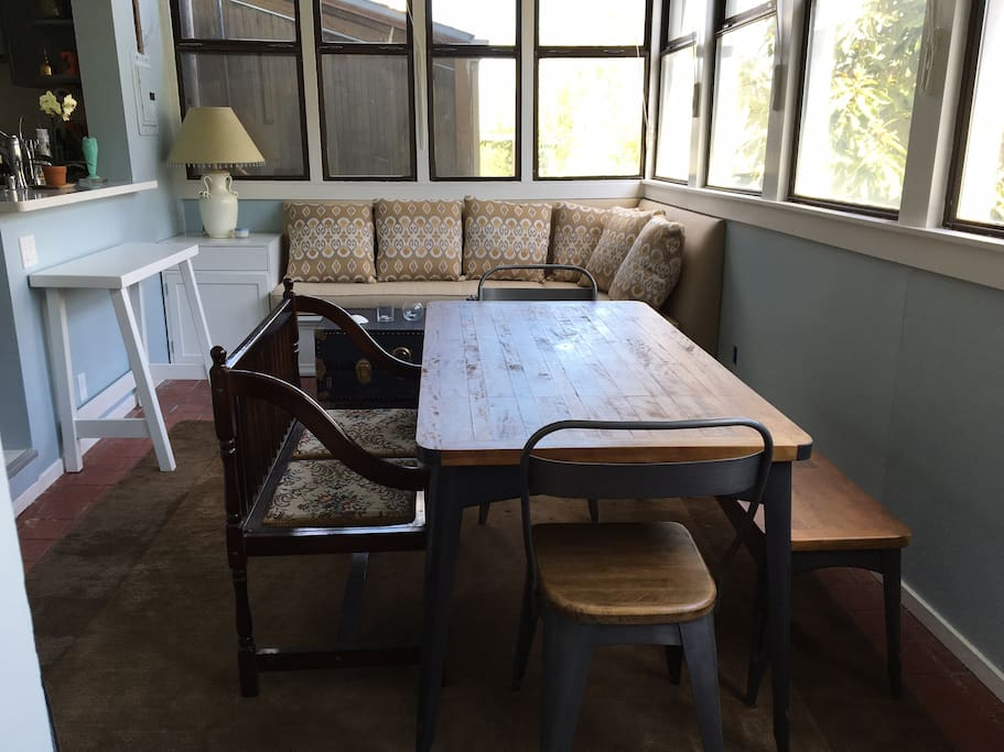 Light filled sunroom off kitchen with dining table