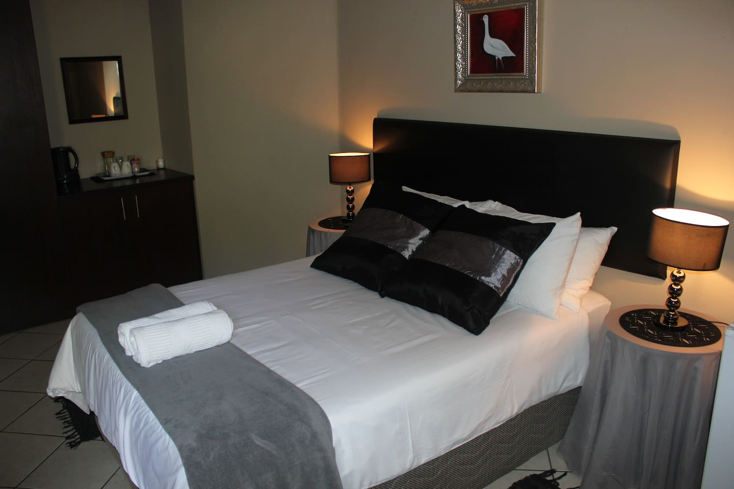 Room 5, double bed with en suite bathroom. TV, fridge and fan in the room. Coffee, tea and sugar is provided. This room has a view over the garden.