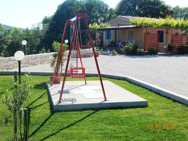Children's swing and plenty of parking space