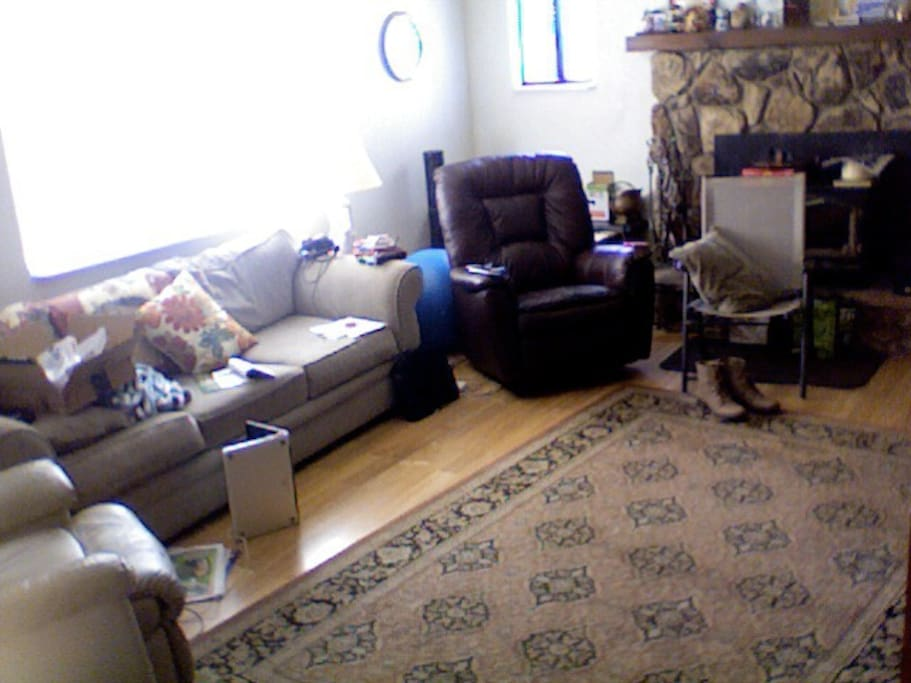 Living room, couch, two recliners, a fireplace, and TV