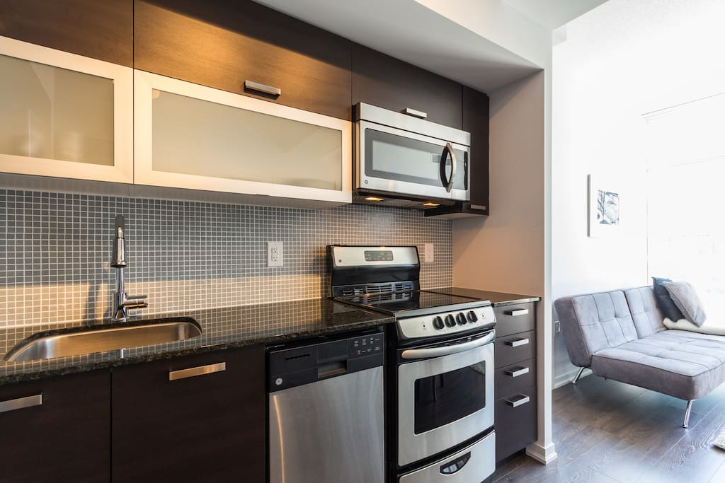 The gorgeous kitchen has everything you need and is sparkling new!!