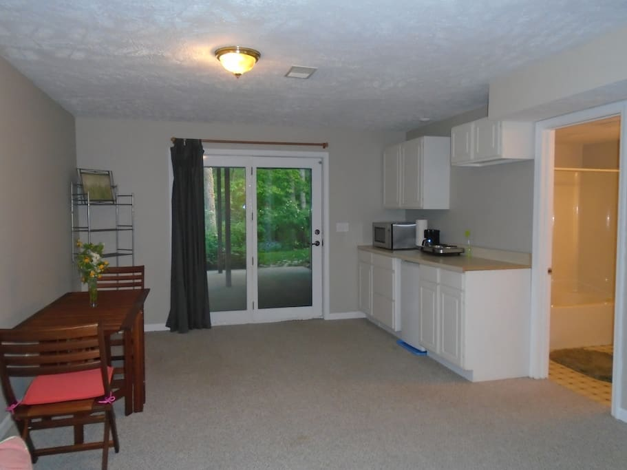 Kitchenette features a Microwave, 2 Burner Cooktop, Coffee Maker and Mini Fridge. Dishes, Cooking Utensils and Silverware Included.