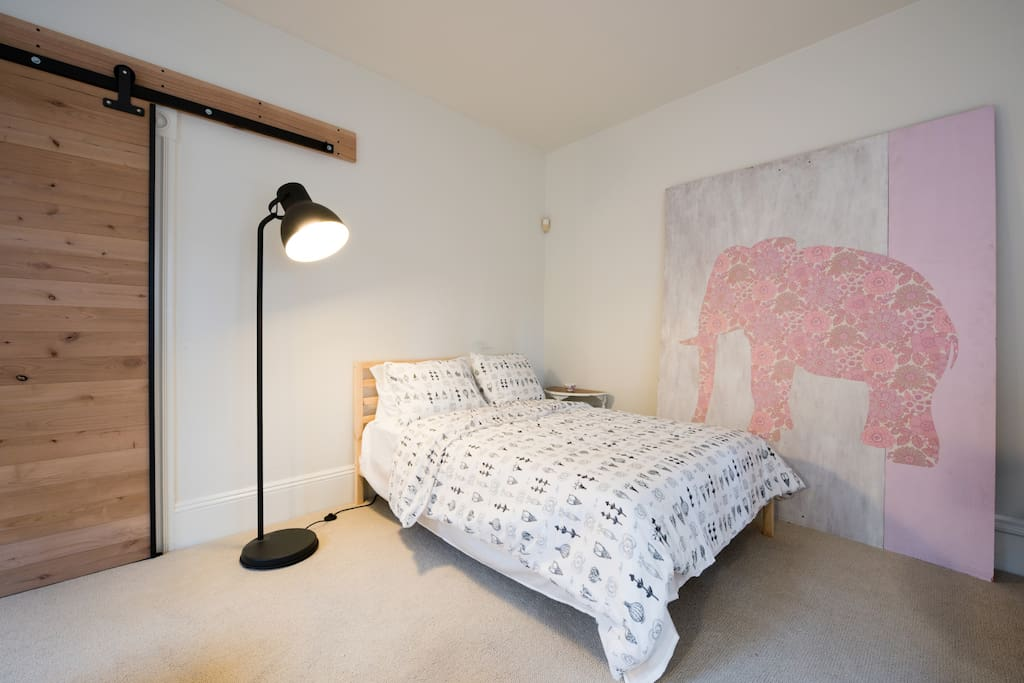 The bedrooms are both spacious and furnished in a modern style
