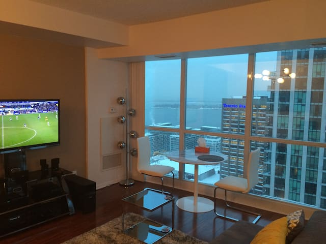 46 inch HD television; dining table with a view of the lake.