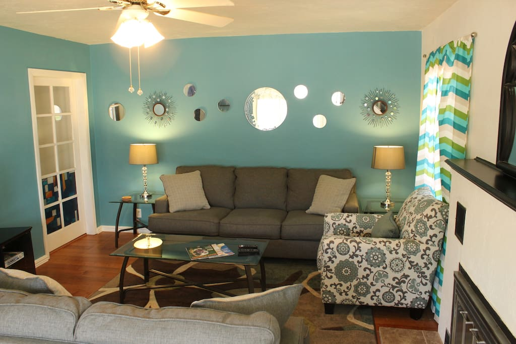 Cheerful, comfortable living room, with all new furniture and flat screen TV.