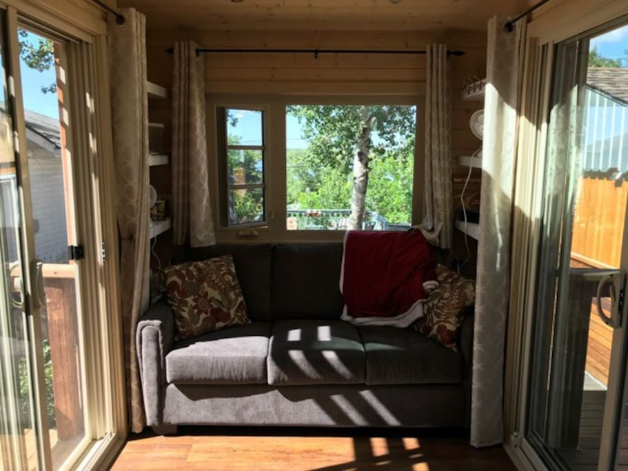 Couch opens into double bed. Wrap up in the soft, comfy throw when watching TV or reading. View of the lake from your picture window.
