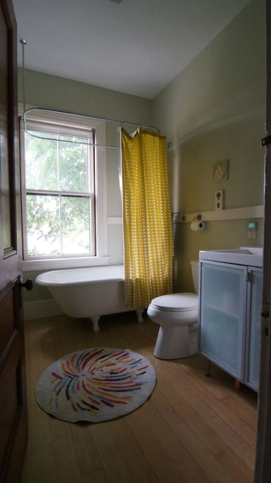 Bathroom with clawfoot tub and shower.