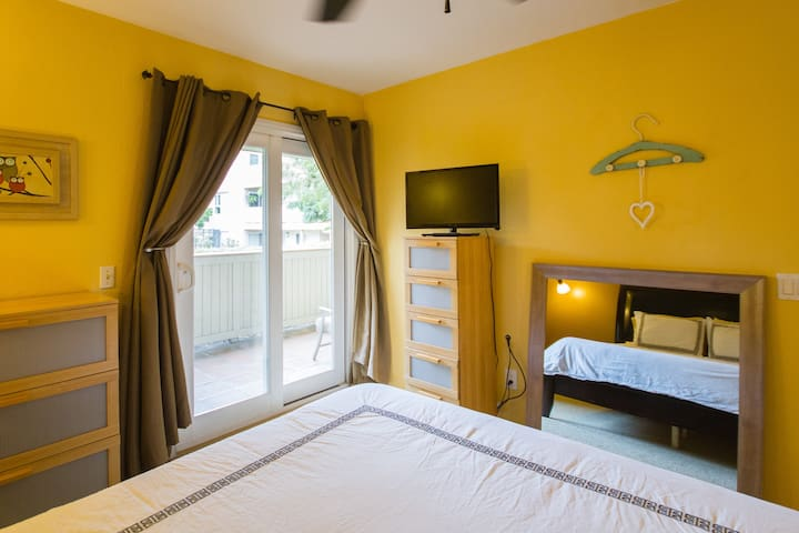 Air Conditioned Bedroom with TV and luxury linens