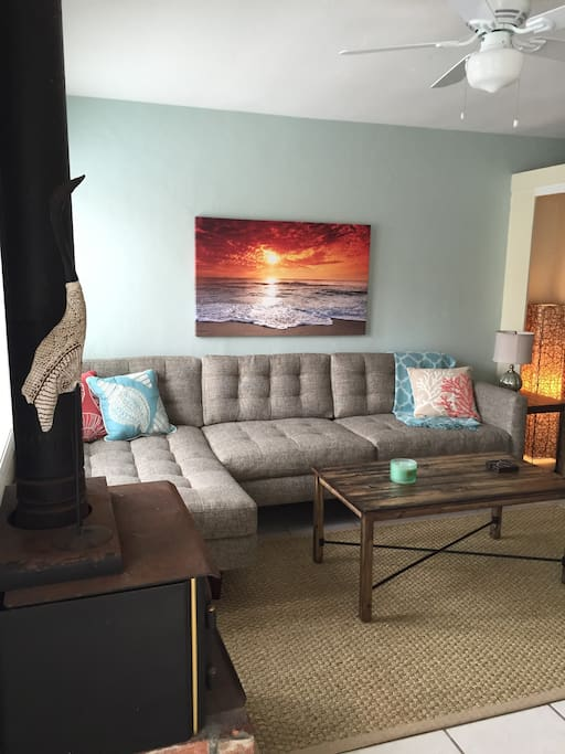 Newly decorated living room.  Very comfortable long couch with chaise for more family members to lounge together while watching T.V. or playing games.