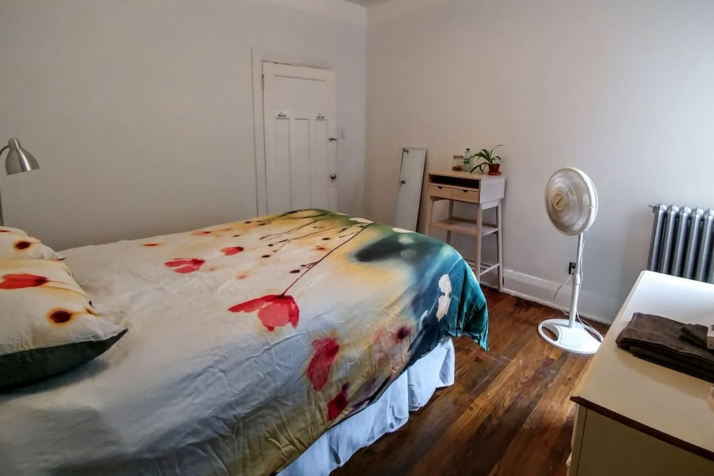 The bright, white bedroom comes complete with a fan, standing desk, dresser, in-room closet & night table -- everything you need for a comfortable stay. Toiletries are provided for short term stays.