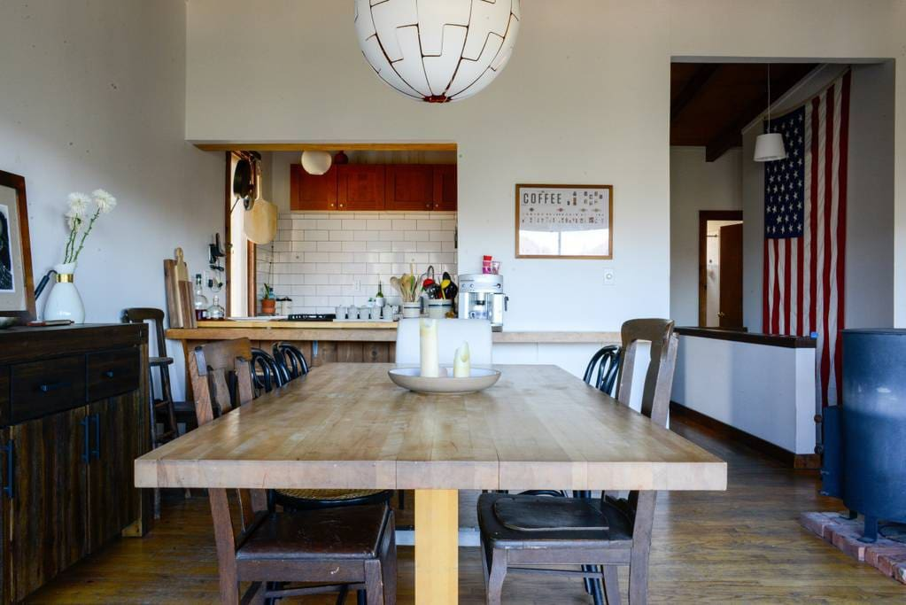Open plan cooking and dining allows for a fun atmosphere. Create memories with Loved ones under our shimmering chandelier!