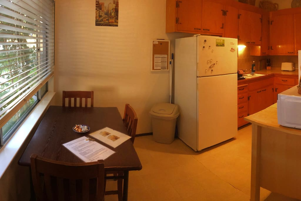 Eat-in kitchen with seating for 4+. Full-size refrigerator.