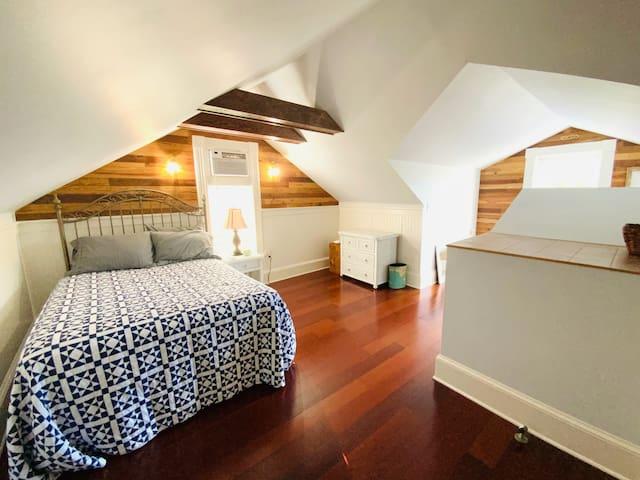 Third floor bedroom with double bed.