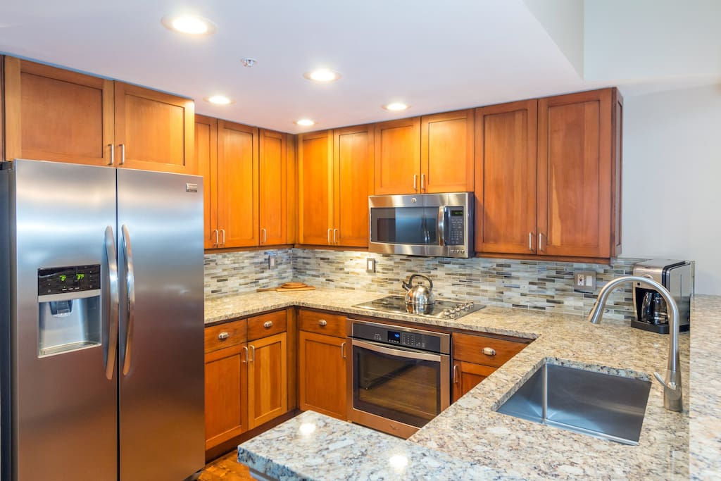 Cook up a delicious dinner in the spacious kitchen with stainless steel appliances and gorgeous countertops.