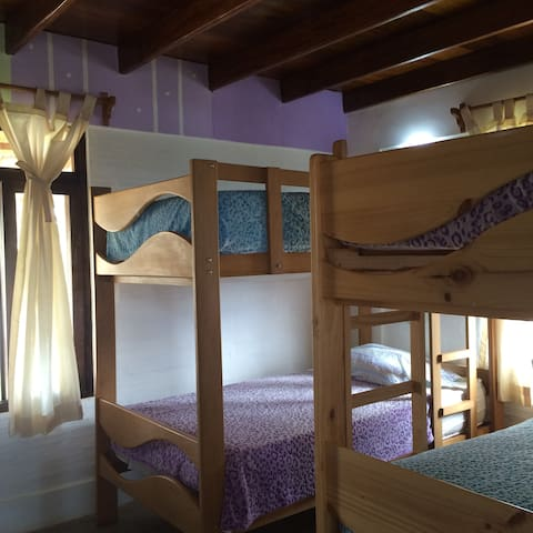 The bunk bedroom with 4 twin size beds