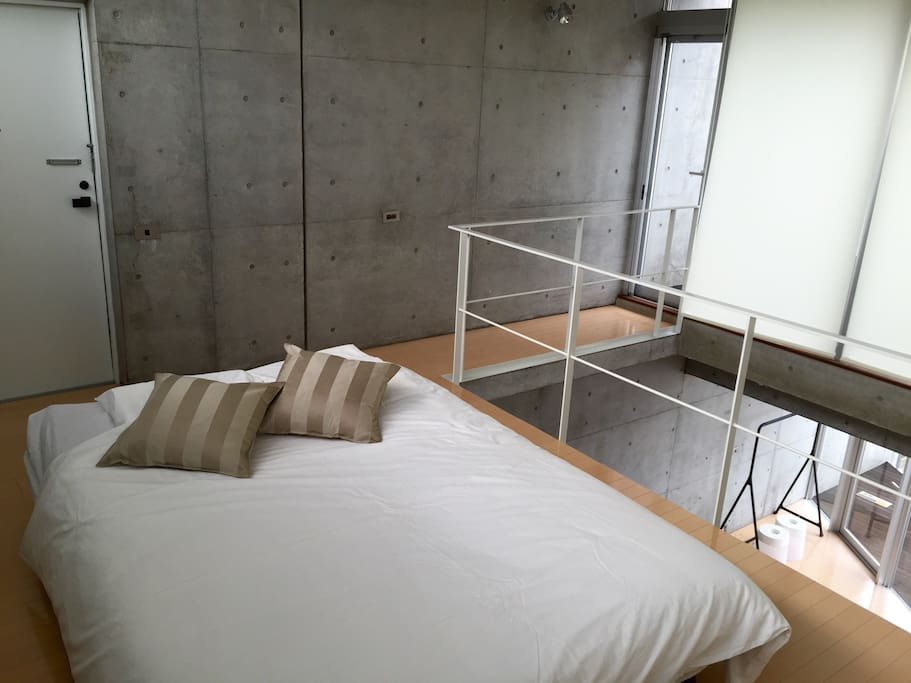 a double bed on the upper floor