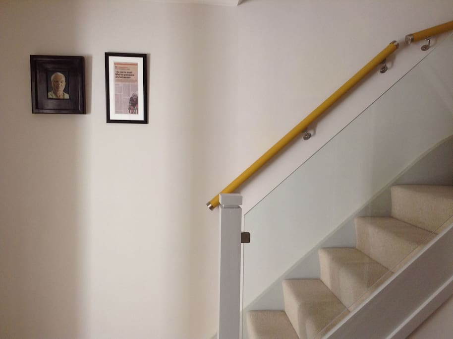 Stairs leading to bedrooms and bathrooms upstairs