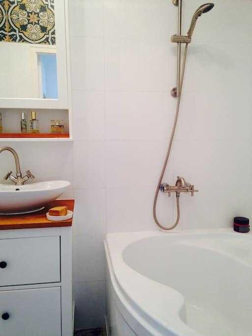 Bathroom with a shower and bath