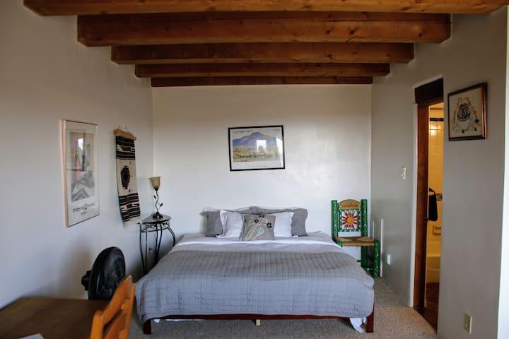 2nd floor bedroom has a king bed, queen bed, fireplace, & balcony.