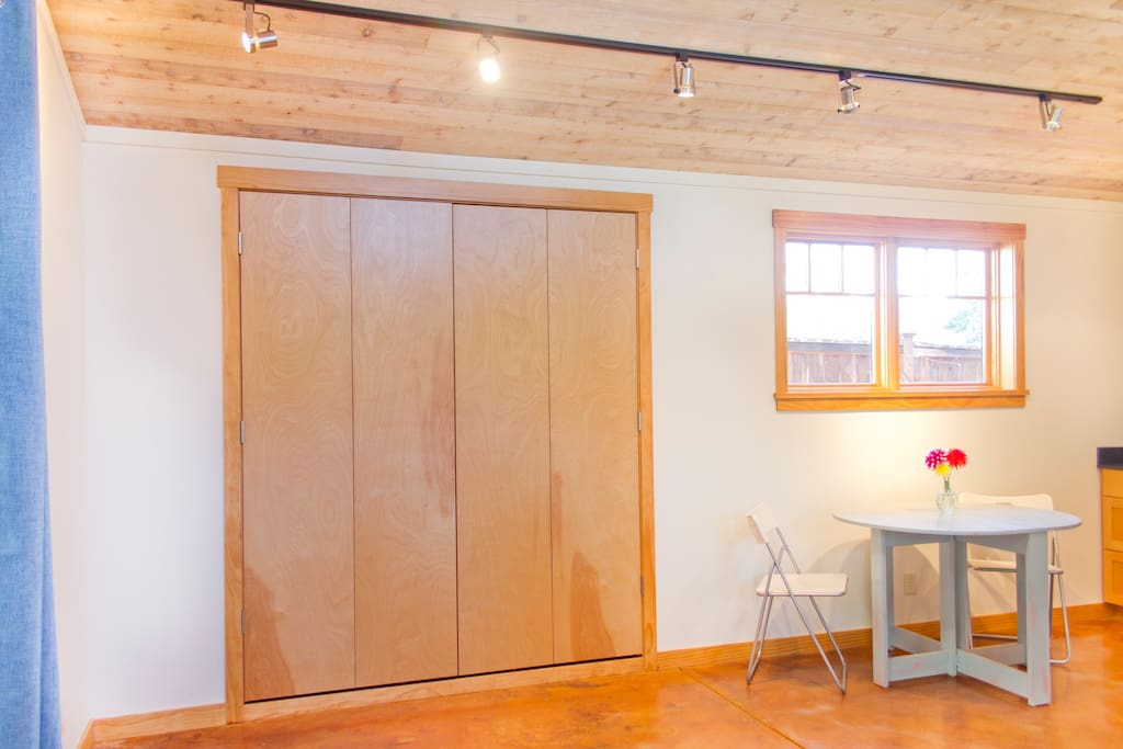 Queen-sized Murphy bed folds neatly and effortlessly into the wall. (Great for yoga!)
