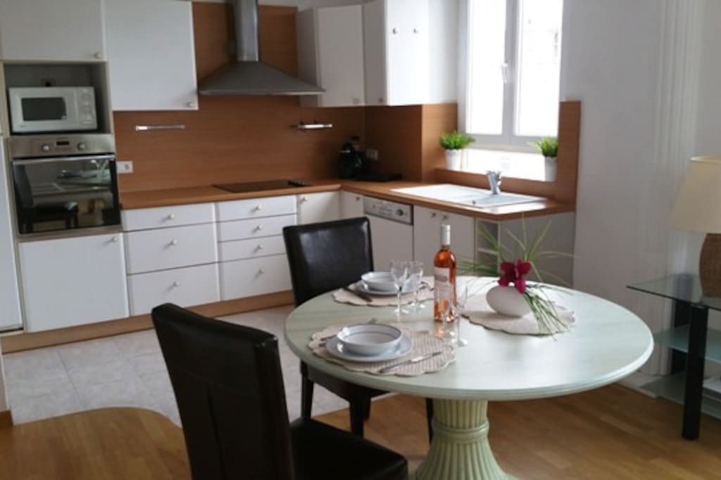 Open fully equipped kitchen and dining room table