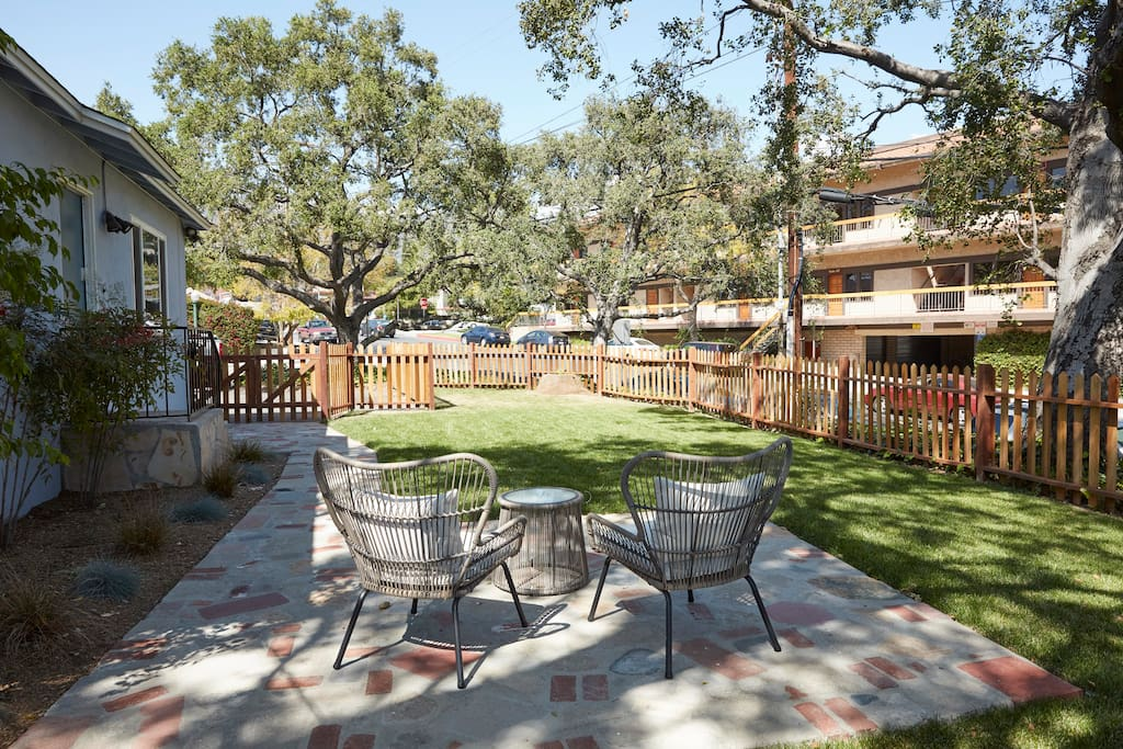 Front yard patio and fenced in lawn area