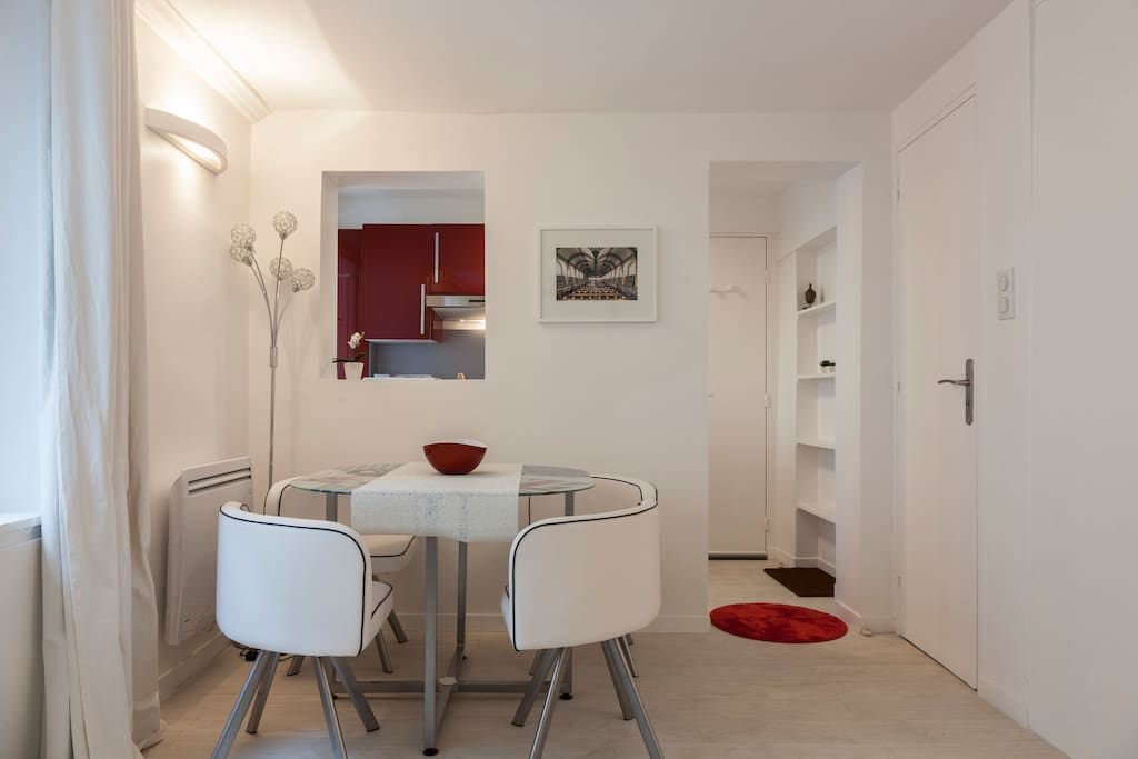 Neat dining table for 4 - new dining set & tablewares are provided in the adjacent kitchen.