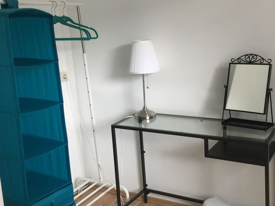 A desk and space for your clothes