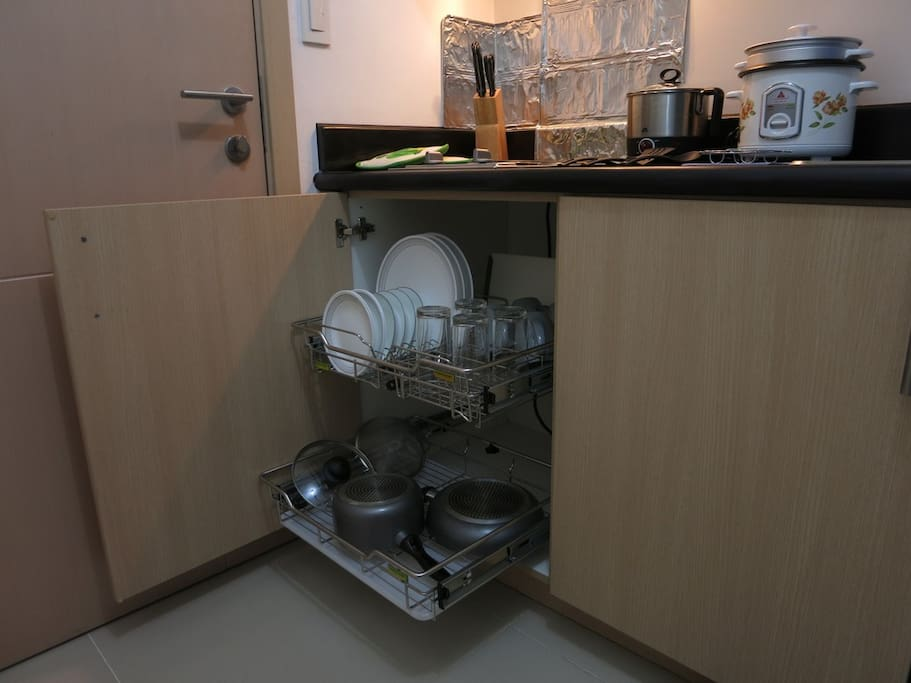 Complete with tableware, cutlery, glasses, cups, pots and pans.