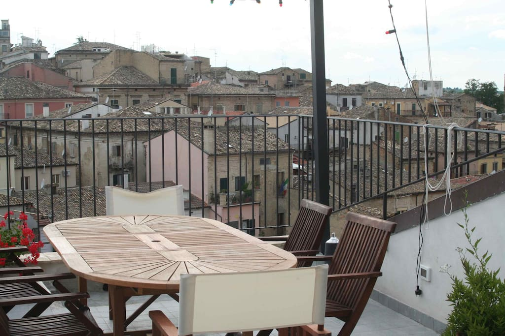 Roof terrace with a view of historical centre and a glimpse of the sea & mountains.