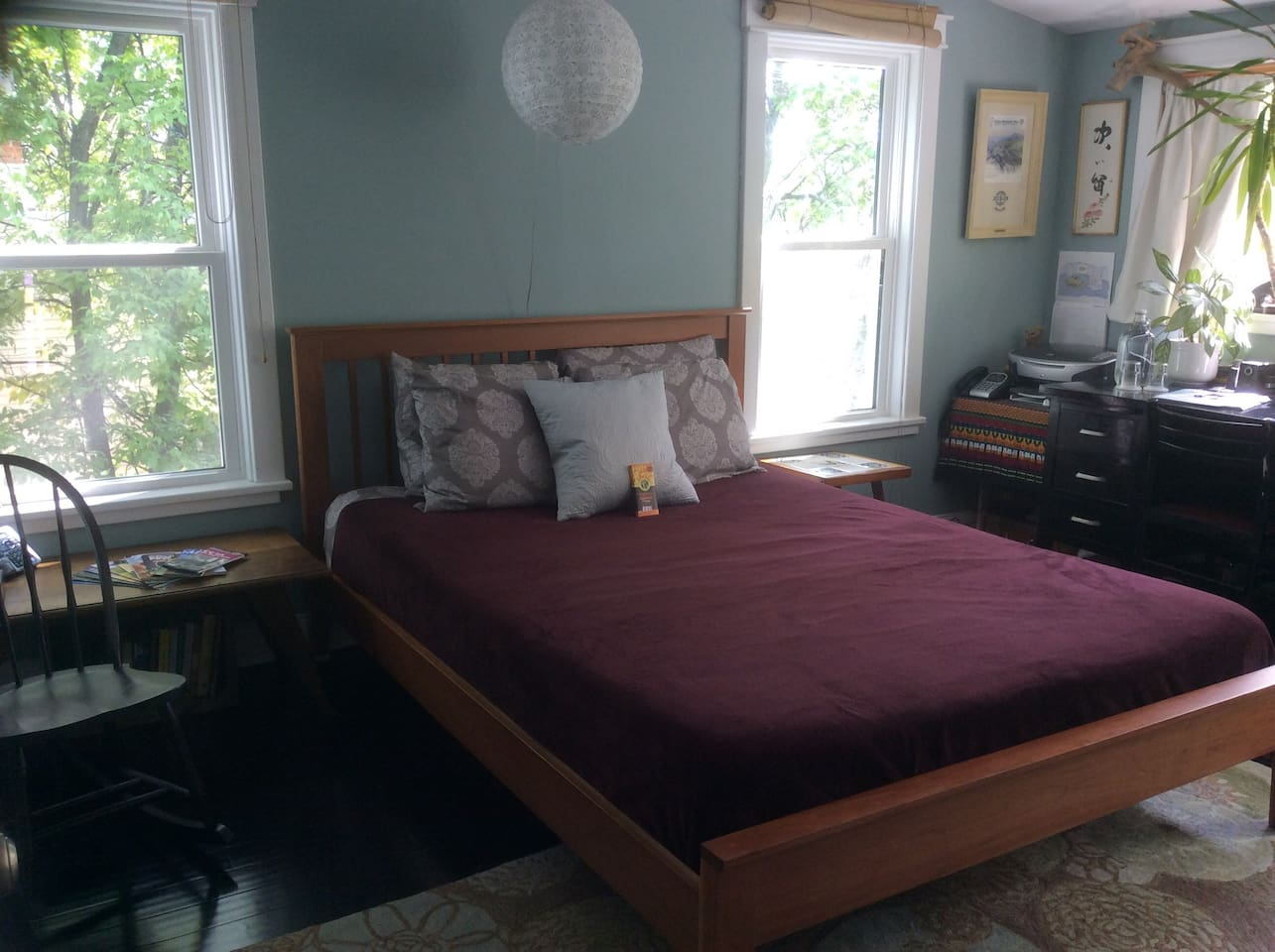Locally made bed frame, tempurpedic queen mattress and lots of sunshine