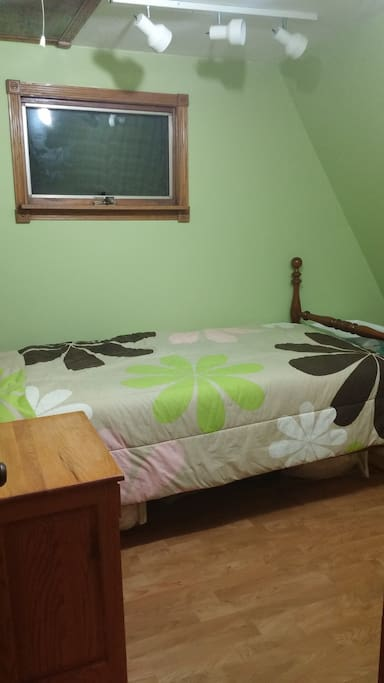 Fourth room with a twin bed