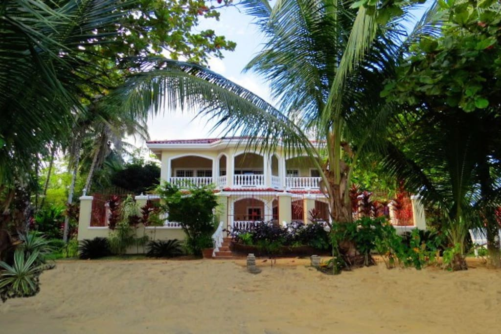 Located DIRECTLY ON the BEACH! This high end Villa was designed to look like a modern turn of the century plantation.