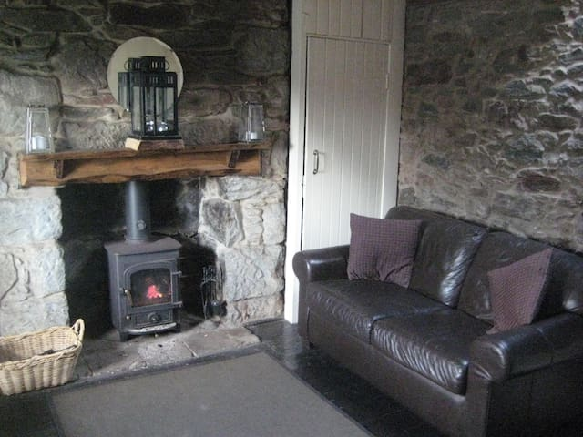 Living room and wood burning stove with back water boiler and enclosed candle holders