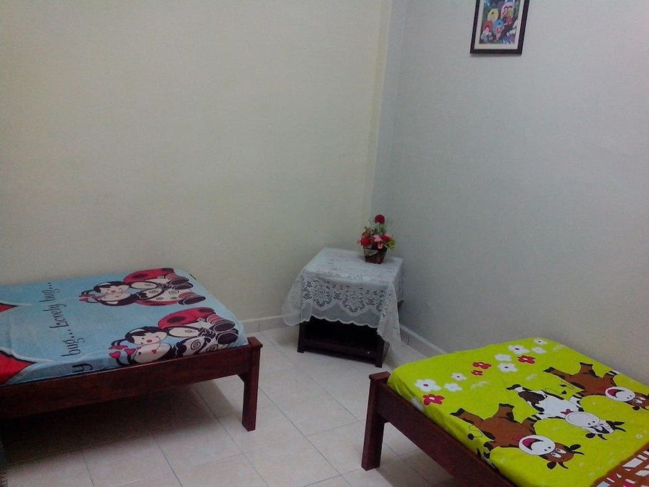 2nd room with two single beds