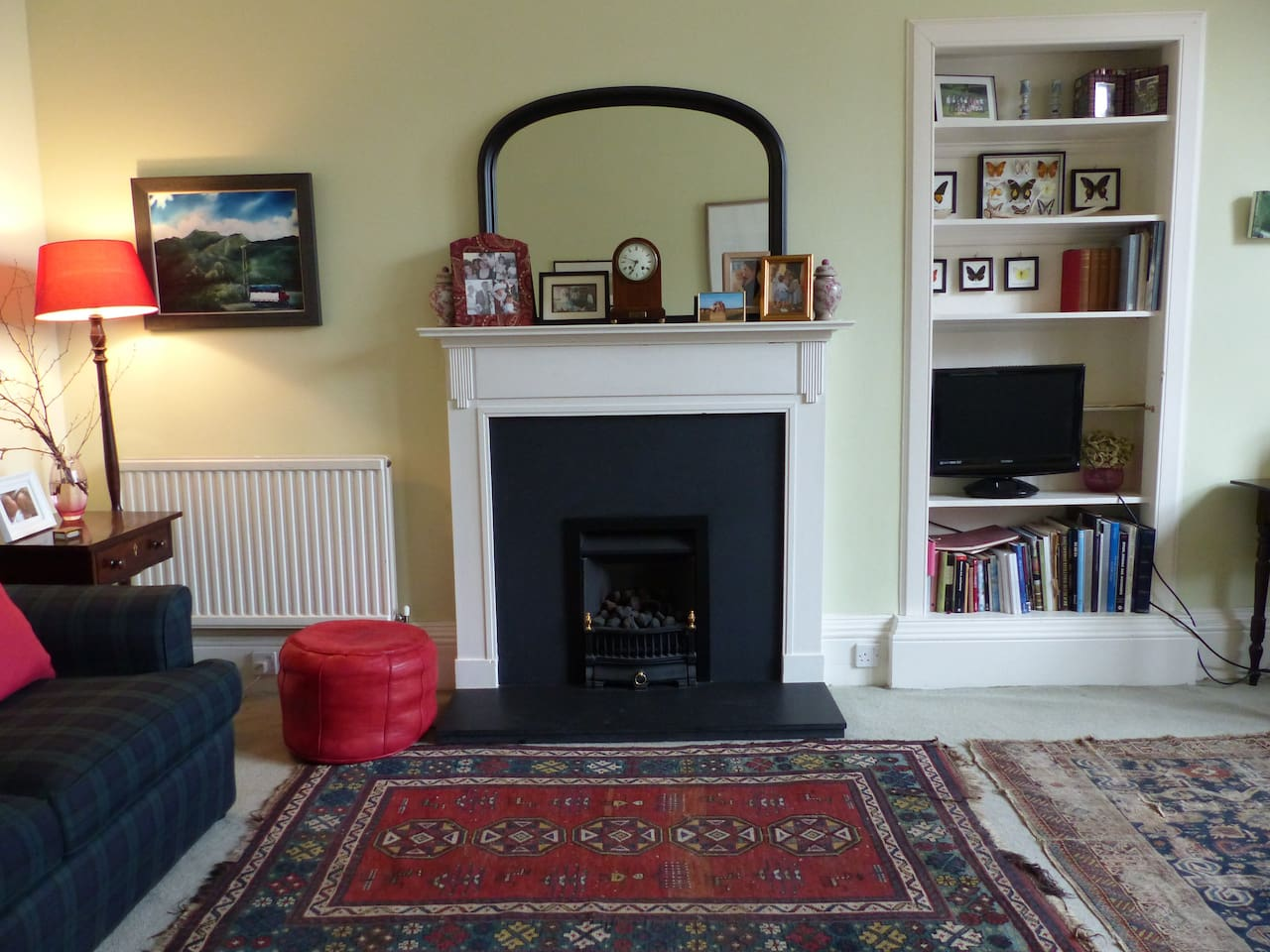 Sitting room with two sofas, table and chairs, cosy gas fire & freeview TV