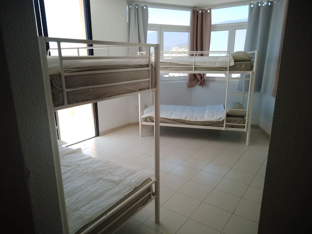 Shared room of 3 bunkbeds in hostel style house