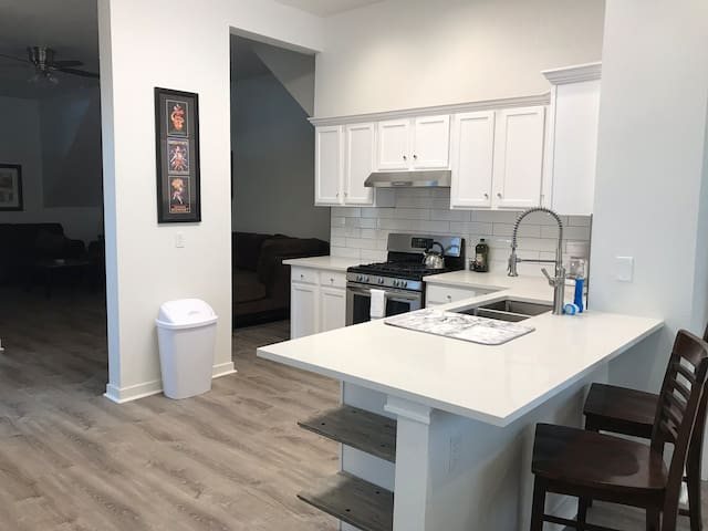 Beautiful newly renovated kitchen, granite countertops, new gas range, stainless appliances, dishwasher!