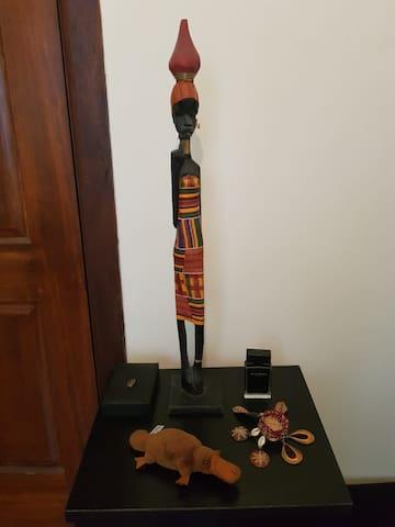 Cosy room in a Rastafarian artsy home .