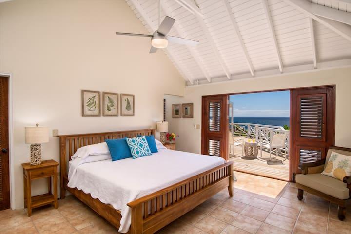 Master bedroom with en-suite bathroom and outdoor shower. King bed.