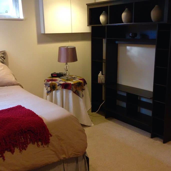The bed side table and wall unit.