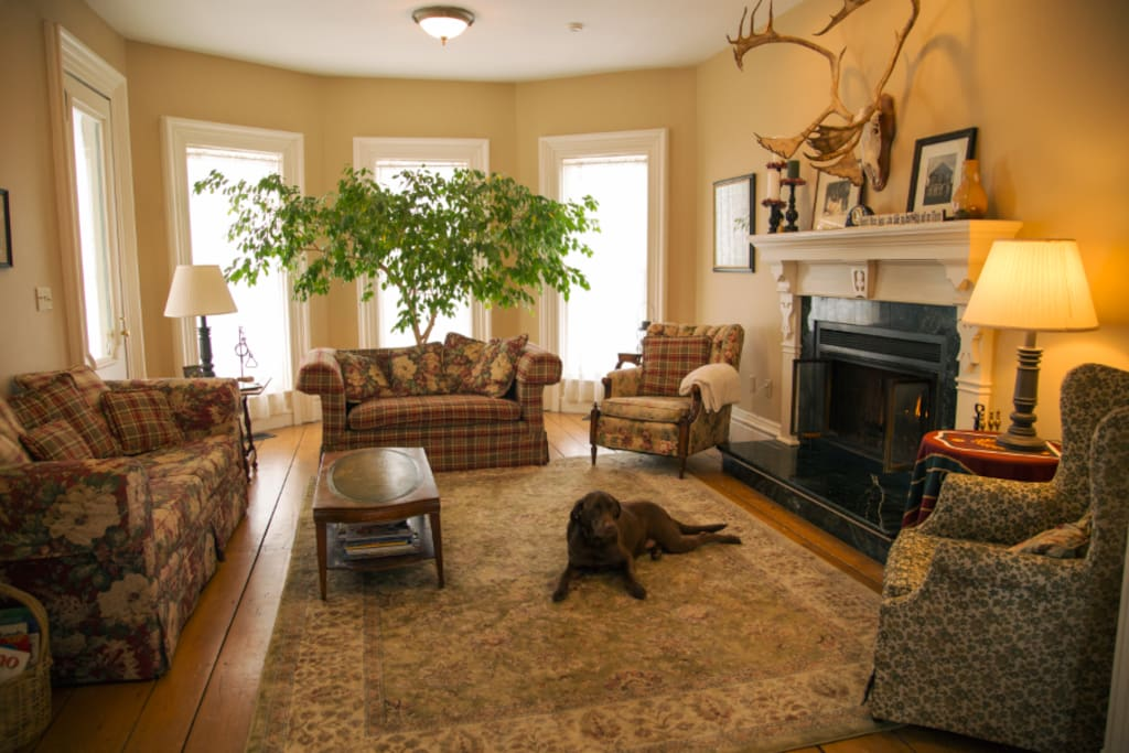 Living room w/ wood fire place.