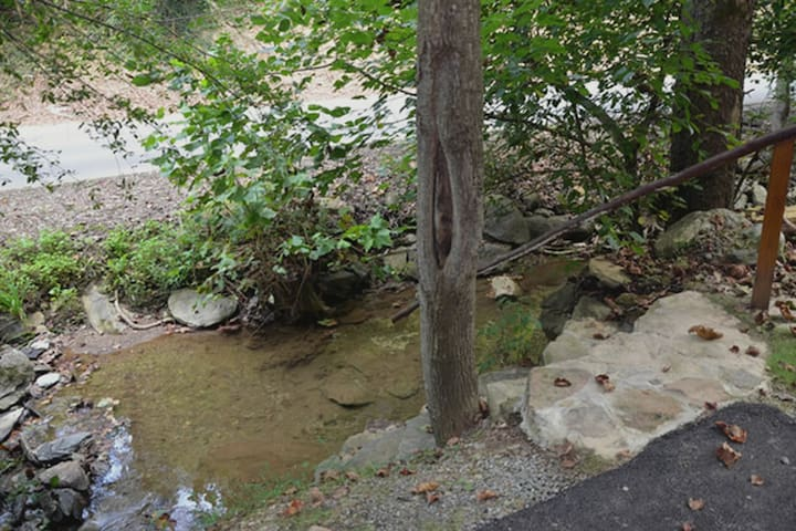 Next to a small creek.